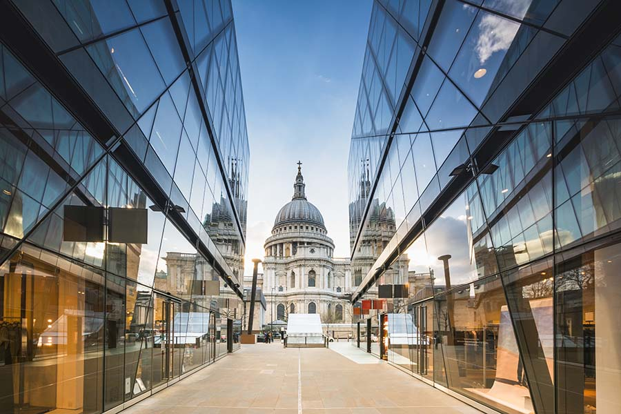Insurance Quote - View of St Pauls Cathedral in London Reflected Off Glass Panels on Modern Building